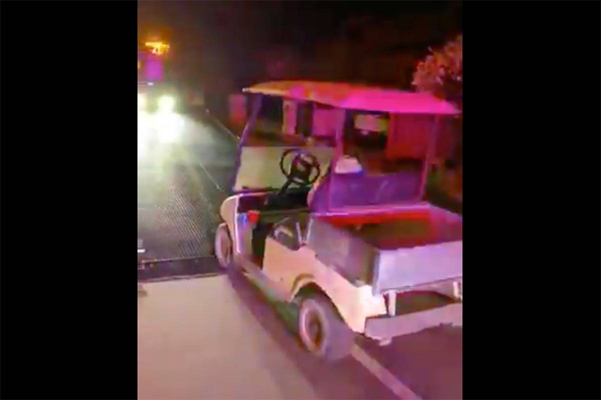 Delta police busted an impaired driver in Tsawwassen early Tuesday morning (April 14) who was found driving a golf cart and wearing a bathrobe and slippers. (Delta Police Department video screenshot)